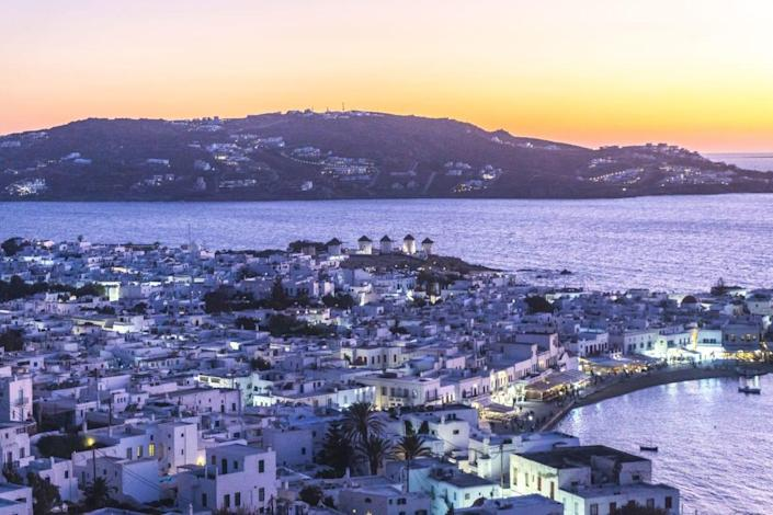 """<div class=""""inline-image__caption""""><p>Overview of the Chora of Mykonos at sunset. </p></div> <div class=""""inline-image__credit"""">Demetrios Ioannou</div>"""