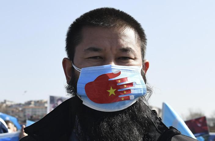 A Uyghur wearing a face mask