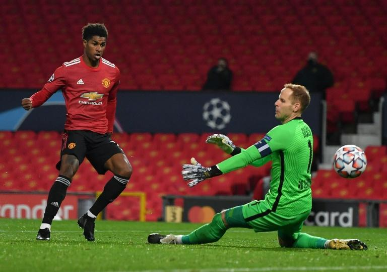 Manchester United forward Marcus Rashford beats RB Leipzig goalkeeper Peter Gulacsi