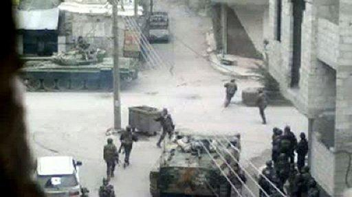 Syrian forces monitoring the streets in Damascus, in an image taken from a video uploaded to YouTube