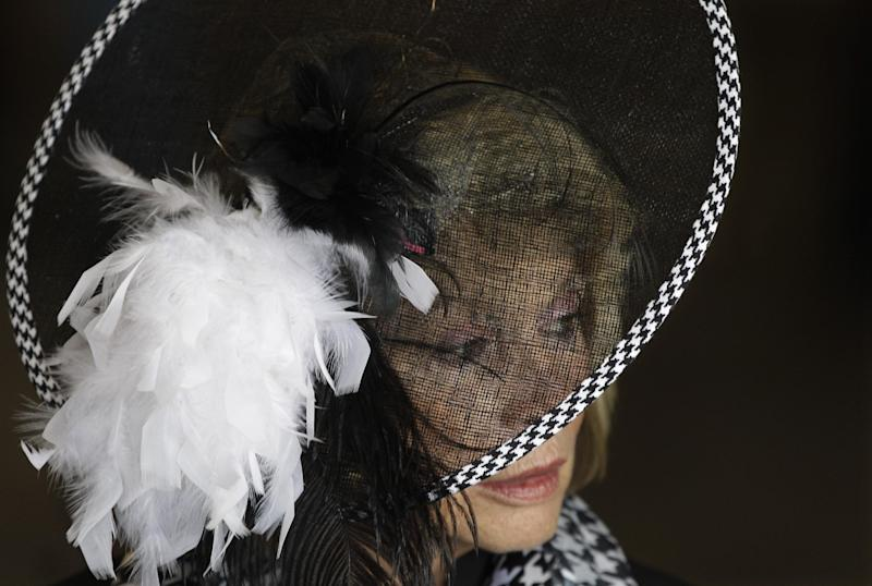 Dawn Paden, from Mountain Home, Ark., wears a fancy hat in the paddock before the 138th Kentucky Derby horse race at Churchill Downs Saturday, May 5, 2012, in Louisville, Ky. (AP Photo/Mark Humphrey)