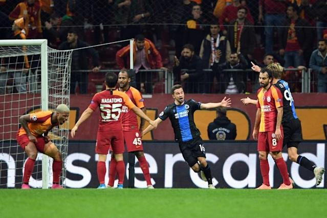 Galatasaray and Club Brugge drew 1-1 in Istanbul on Tuesday, a result that took Real Madrid through to the last 16 of the Champions League (AFP Photo/Bulent Kilic )