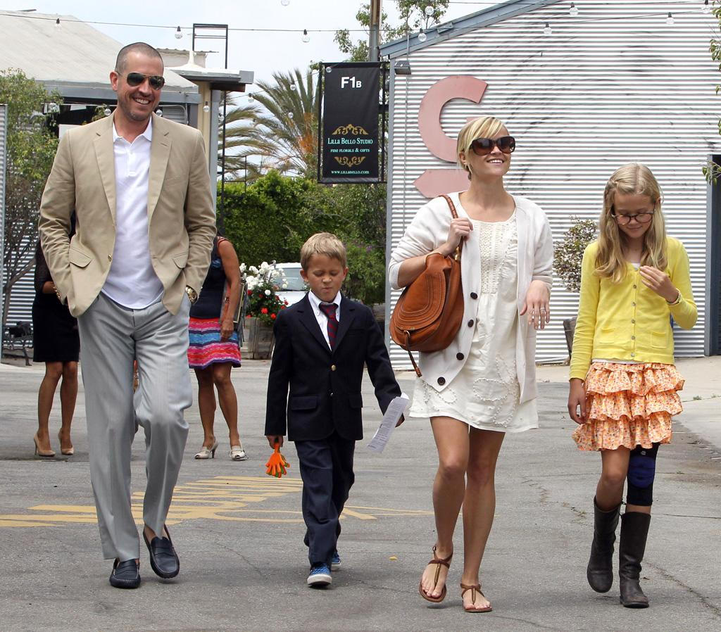 "Reese Witherspoon and her new hubby were all smiles while leaving Easter services in Santa Monica, California, with Reese's children, Deacon, 7, and Ava, 11, on Sunday. The family followed church with brunch at Ivy at the Shore. <a href=""http://www.infdaily.com"" target=""new"">INFDaily.com</a> - April 25, 2011"