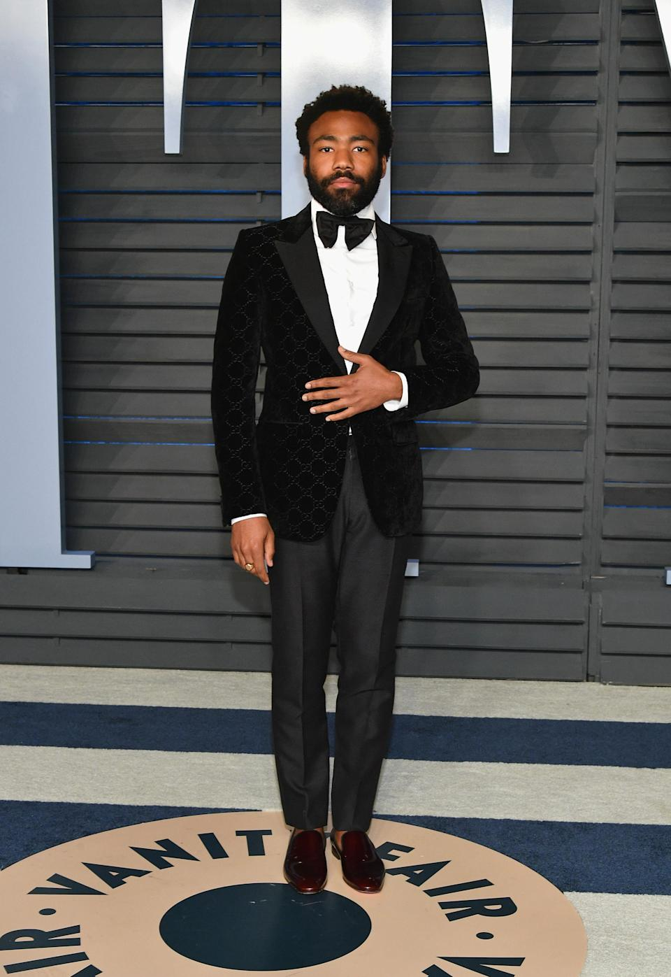 <p>Proving his sartorial prowess, Donald Glover wore a slick Gucci tux for the awards night. <em>[Photo: Getty]</em> </p>
