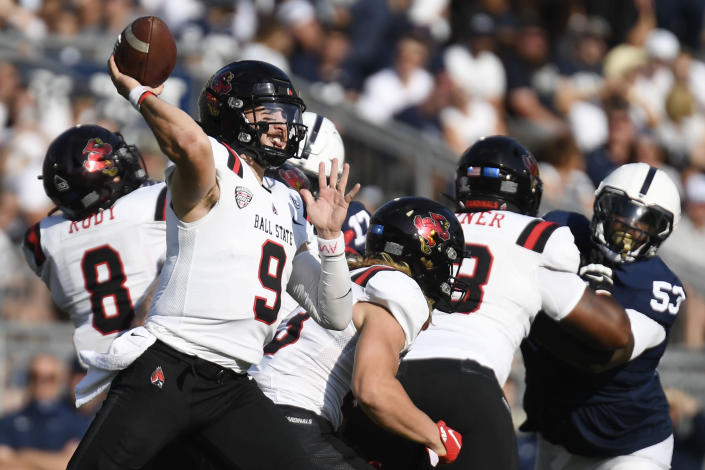 Ball State quarterback Drew Plitt (9) passes against Penn State during the first half of an NCAA college football game in State College, Pa., Saturday, Sept. 11, 2021. (AP Photo/Barry Reeger)