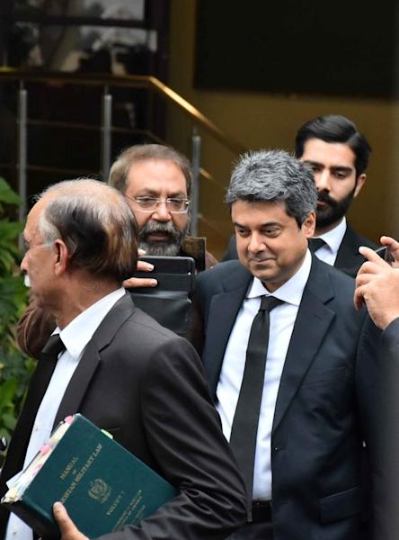 Mohammad Farogh Naseem, defence lawyer of the Pakistan's Chief of Army Staff (COAS) General Qamar Javed Bajwa, walks with lawyers as he leaves the Supreme Court premises in Islamabad