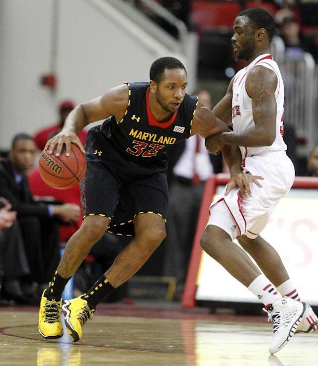 Maryland's Dez Wells (32) is guarded by N.C. State's Desmond Lee (5) during the first half of N.C. State's game against Maryland at PNC Arena in Raleigh, N.C. Monday, Jan. 20, 2014. (AP Photo/The News & Observer, Ethan Hyman)
