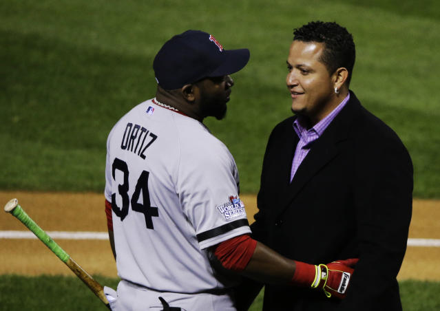 Detroit Tigers' Miguel Cabrera chats with Boston Red Sox's David Ortiz after he was awarded the 2013 Hank Aaron Award before Game 4 of baseball's World Series between the St. Louis Cardinals and the Boston Red Sox, Sunday, Oct. 27, 2013, in St. Louis. (AP Photo/Charlie Neibergall)