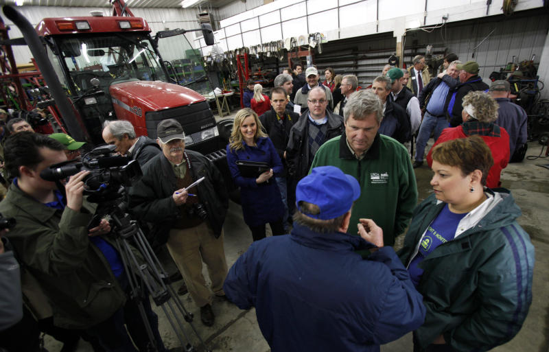 U.S. Agriculture Secretary Tom Vilsack and U.S. Environmental Protection Agency Administrator Lisa Jackson, right, talk with Gordon Wassenaar during a visit to his farm on  Tuesday, April 19, 2011, in Prairie City, Iowa. (AP Photo/Charlie Neibergall)