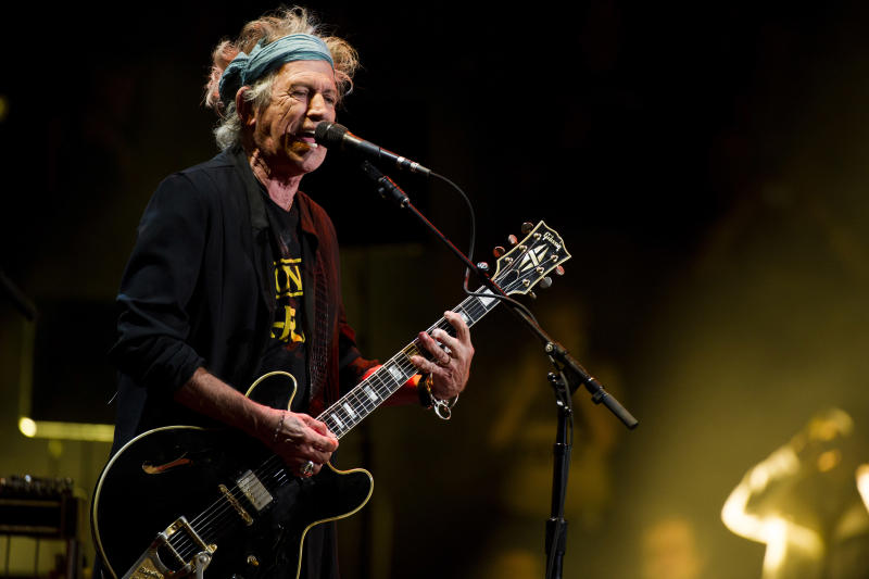 """FILE - This April 13, 2013 file photo shows Keith Richards performing at Eric Clapton's Crossroads Guitar Festival 2013 at Madison Square Garden in New York. Keith Richards says he doesn't own an iPod.The 69-year-old believes music lovers are """"all being short-changed"""" with the sound that comes out of an iPod, launched in 2001. The Rolling Stones' """"50 & Counting Tour"""" kicks off Friday in Los Angeles.  (Photo by Charles Sykes/Invision/AP, file)"""