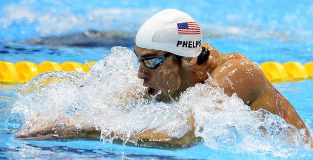 USA's Michael Phelps races the men's 400 meter medley heat at the Aquatic Centre in the Olympic Village at the 2012 Summer Olympics in London on Saturday, July 28, 2012. (AP Photo/The Canadian Press, Sean Kilpatrick)