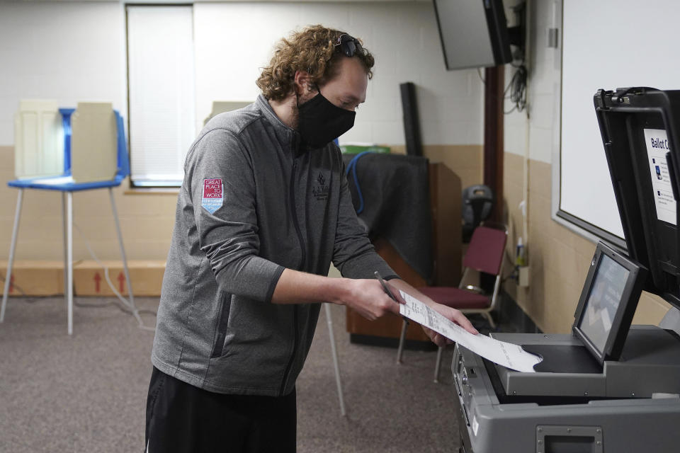 Robert Rodriguez cast his primary ballot at the Minnesota Army National Guard N.E. Minneapolis Training and Community Center Tuesday, Aug. 11, 2020 in Minneapolis. (Anthony Souffle/Star Tribune via AP)