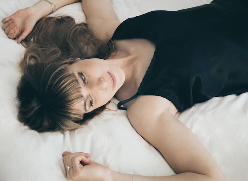 Woman in bed looking away