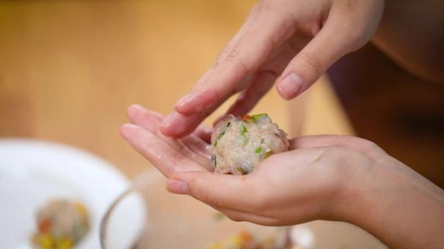 shaping seafood meatball with hands