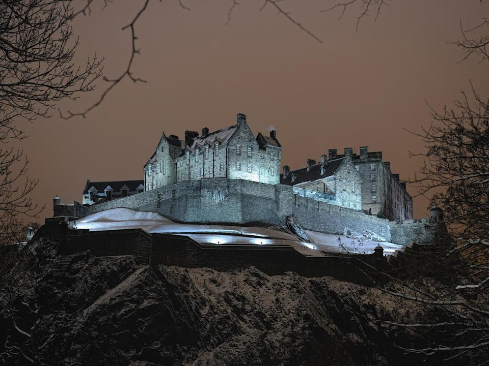 "One of the biggest attractions in <a href=""https://www.cntraveler.com/destinations/edinburgh?mbid=synd_yahoo_rss"" rel=""nofollow noopener"" target=""_blank"" data-ylk=""slk:Scotland's capital city"" class=""link rapid-noclick-resp"">Scotland's capital city</a> is also, according to many, one of its most haunted. With parts dating back more than 900 years, the historic fortress's ancient dungeons have led visitors to the castle to report ""visits"" from colonial prisoners from the American Revolutionary War, French prisoners from the Seven Years War—and even the ghost of a dog wandering the cemetery on the castle's grounds."