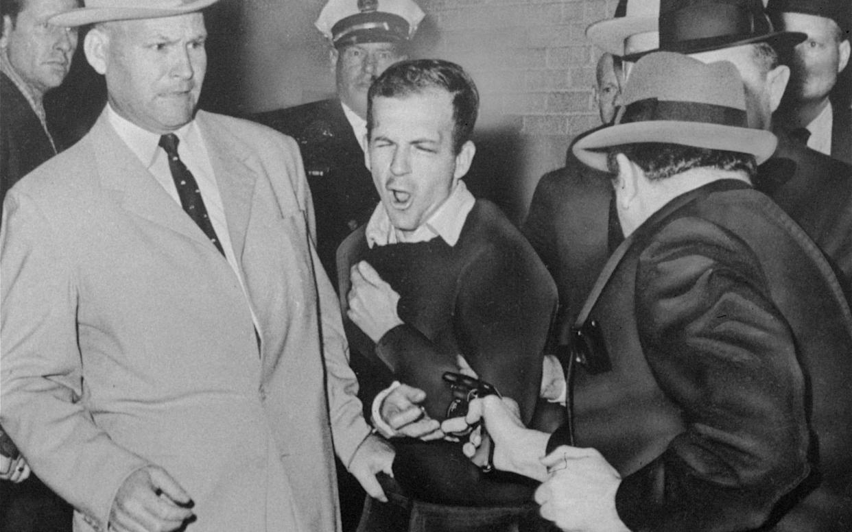 Lee Harvey Oswald, accused of assassinating John F Kennedy, is shot by Dalas nightclub owner Jack Ruby - AP