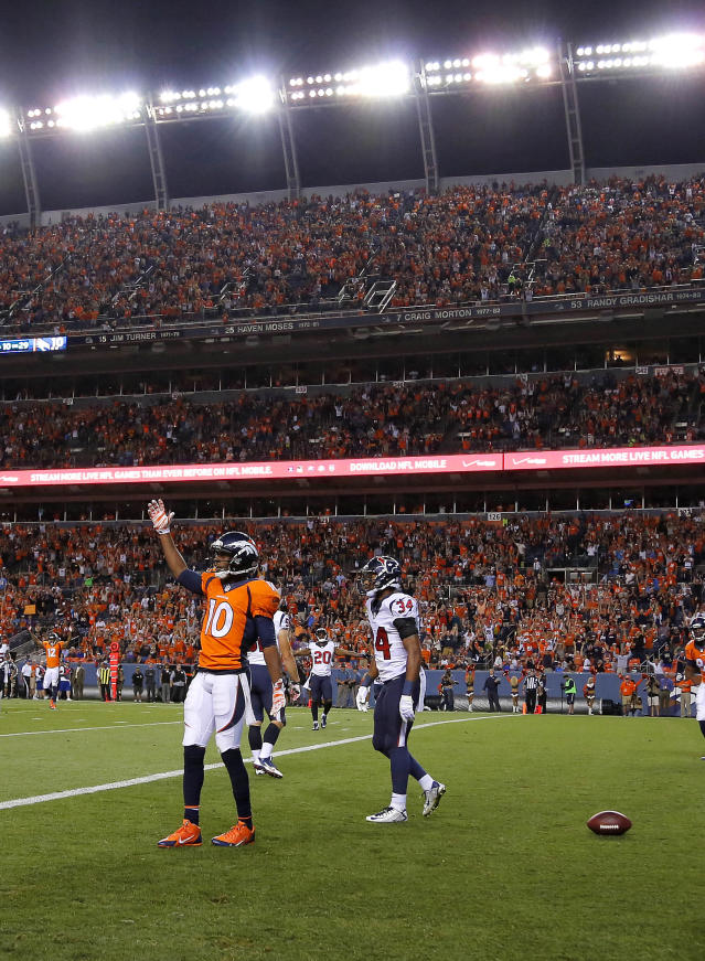 Denver Broncos wide receiver Emmanuel Sanders (10) celebrates his touchdown as Houston Texans cornerback A.J. Bouye (34) walks away during the first half of an NFL preseason football game, Saturday, Aug. 23, 2014, in Denver. (AP Photo/Jack Dempsey)