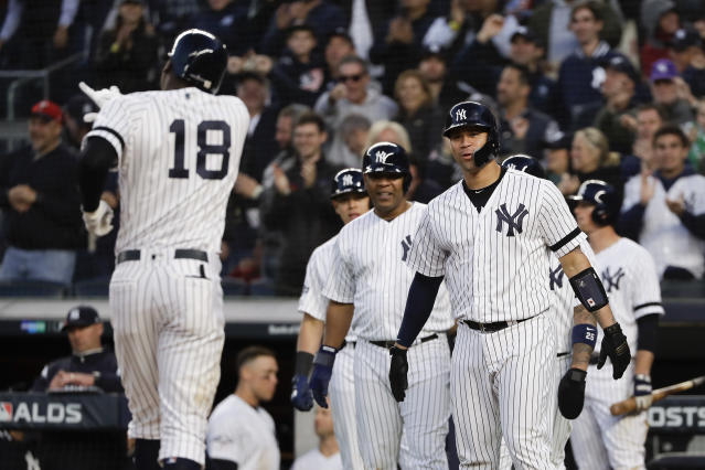 New York Yankees catcher Gary Sanchez and teammates await Didi Gregorius as he approaches home plate after hitting a grand slam home run against the Minnesota Twins during the third inning of Game 2 of an American League Division Series baseball game, Saturday, Oct. 5, 2019, in New York. (AP Photo/Frank Franklin II)