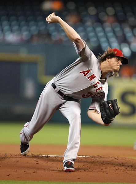 Los Angeles Angels Jered Weaver delivers a pitch to the Houston Astros in the first inning of a baseball game Saturday, Sept. 14, 2013 at Minute Maid Park in Houston. (AP Photo/Eric Christian Smith)