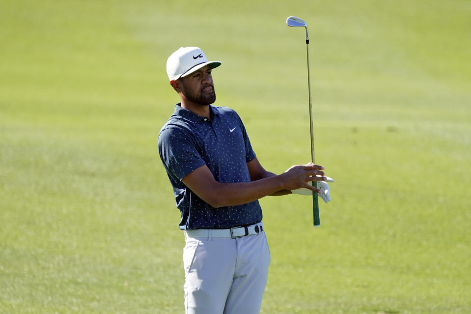 Tony Finau watches his approach shot from the first fairway during the final round of The American Express golf tournament on the Pete Dye Stadium Course at PGA West, Sunday, Jan. 24, 2021, in La Quinta, Calif. (AP Photo/Marcio Jose Sanchez)