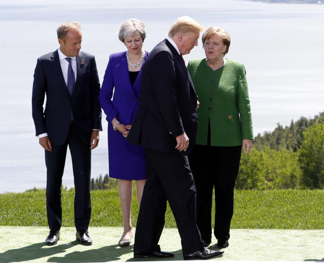 <p>European Council President Donald Tusk, Britain's Prime Minister Theresa May and Germany's Chancellor Angela Merkel look at U.S. President Donald Trump during a family photo at the G7 Summit in the Charlevoix city of La Malbaie, Quebec, Canada, June 8, 2018. (Photo: Yves Herman/Reuters) </p>