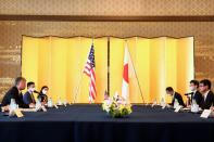 U.S. Deputy Secretary of State Stephen Biegun, left, the top U.S. official on North Korea, speaks as Japan's Defense Minister Taro Kono, right, listens during a bilateral meeting in Tokyo Friday, July 10, 2020. (Behrouz Mehri/Pool Photo via AP)