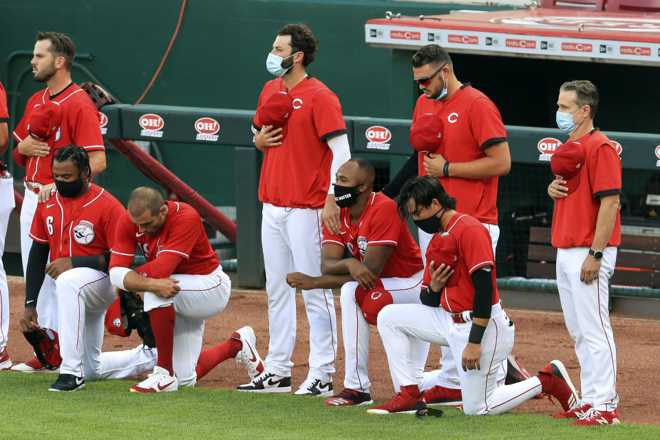 MLB players continue to kneel in protest of social injustice and police brutality. (AP Photo/Aaron Doster)