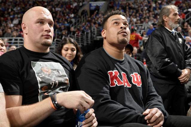 Eagles' Lane Johnson and Brandon Brooks attend the game between the Cleveland Cavaliers and the Philadelphia 76ers on March 12, 2019 at the Wells Fargo Center in Philadelphia, Pennsylvania. (Photo by David Dow/NBAE via Getty Images)