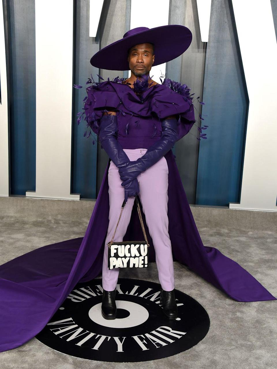 <p>Porter at the <em>Vanity Fai</em>r Oscars Party in lavender trousers, a pronounced purple top with feathers and long train, a wide-brim hat, and a shoulder bag. </p>