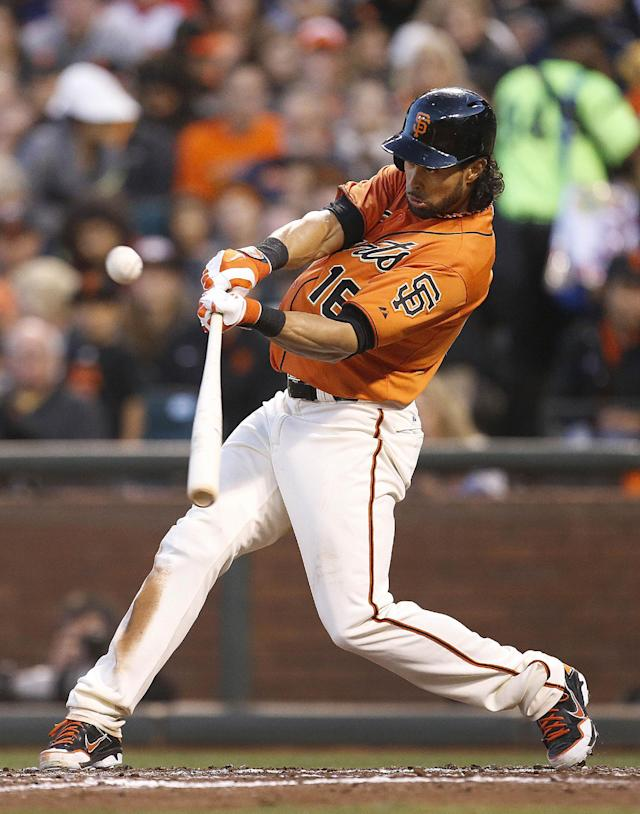 San Francisco Giants' Angel Pagan (16) hits a triple against the Minnesota Twins starting pitcher Kyle Gibson in the third inning of a baseball game Friday, May 23, 2014, in San Francisco. (AP Photo/Tony Avelar)
