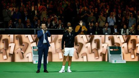 Tennis - ATP 500 - Rotterdam Open - Quarterfinal - Ahoy, Rotterdam, Netherlands - February 16, 2018 Roger Federer of Switzerland and Tournament Director Richard Krajicek acknowledge the audience. REUTERS/Michael Kooren