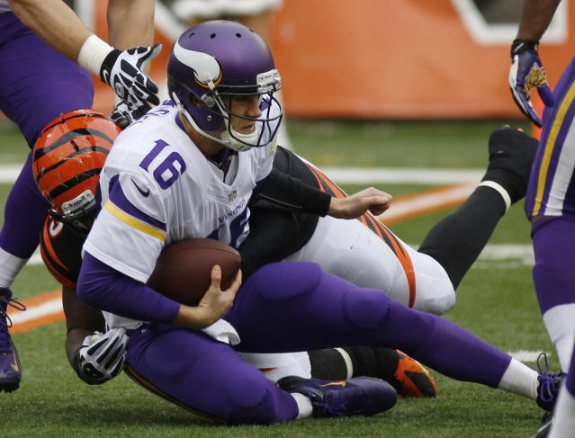 Minnesota Vikings quarterback Matt Cassel (16) is sacked by Cincinnati Bengals outside linebacker Vontaze Burfict during the second half of an NFL football game, Sunday, Dec. 22, 2013, in Cincinnati. (AP Photo/David Kohl)