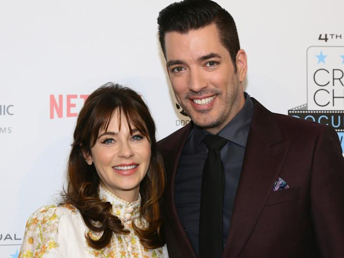 Zooey Deschanel and Jonathan Scott at a red carpet in November 2019.