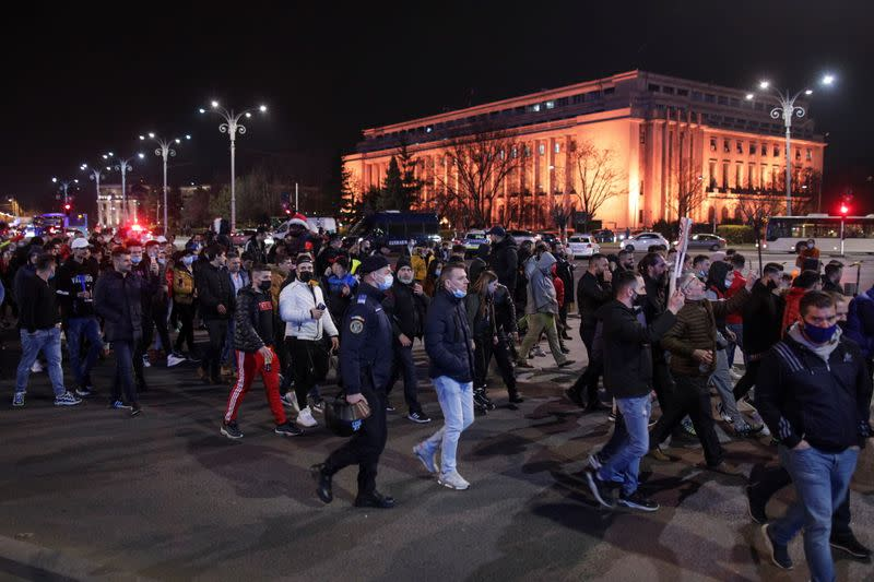 People march in downtown Bucharest demanding an end to coronavirus restrictions