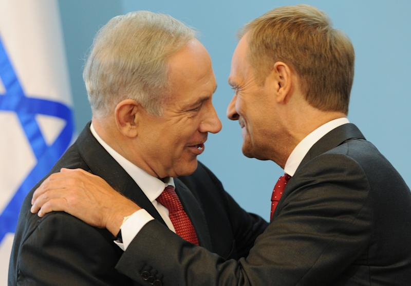 Israeli Prime Minister Benjamin Netanyahu, left, and his Polish counterpart Donald Tusk hug each other after a press conference in Warsaw, Poland, Wednesday, June 12, 2013. Netanyahu came to Poland for a two day visit for talks with Tusk and to attend the opening of a Holocaust exhibition in the former German Nazi Death Camp Auschwitz Birkenau. (AP Photo/Alik Keplicz)