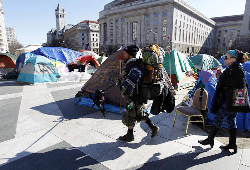 A Occupy DC demonstrator leaves with his belongings from Freedom Plaza in Washington, Monday,  Jan. 30, 2012. U.S. Park Police plan to begin enforcing a no-camping rule at two Washington sites where Occupy protesters have been demonstrating for months. (AP Photo/Jose Luis Magana)