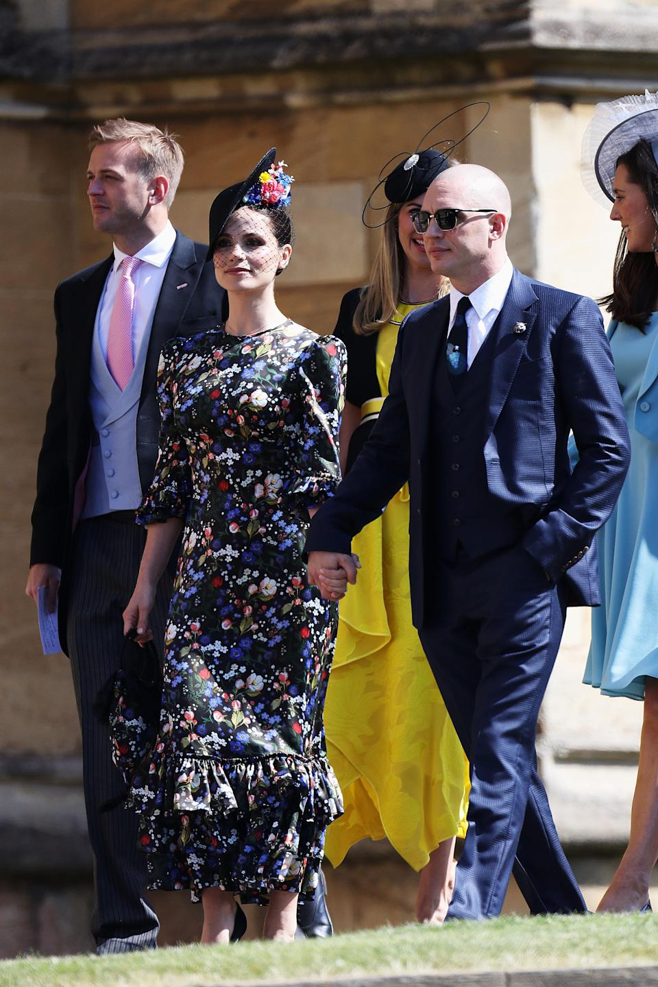 <p>The British actor arrives (sans hair for his new film role) wife wife Charlotte Riley. <em>[Photo: PA]</em> </p>