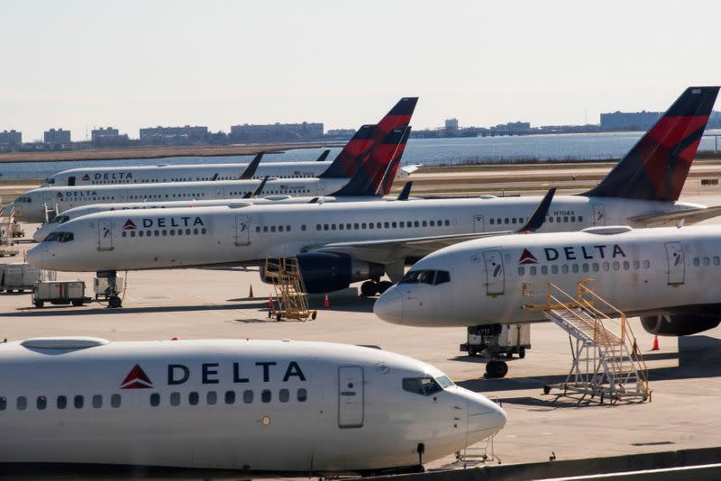 FILE PHOTO: Delta planes are seen at the platform after the Federal Aviation Administration (FAA) temporarily halted flights arriving at New York City airports due to coronavirus disease (COVID-19) in New York