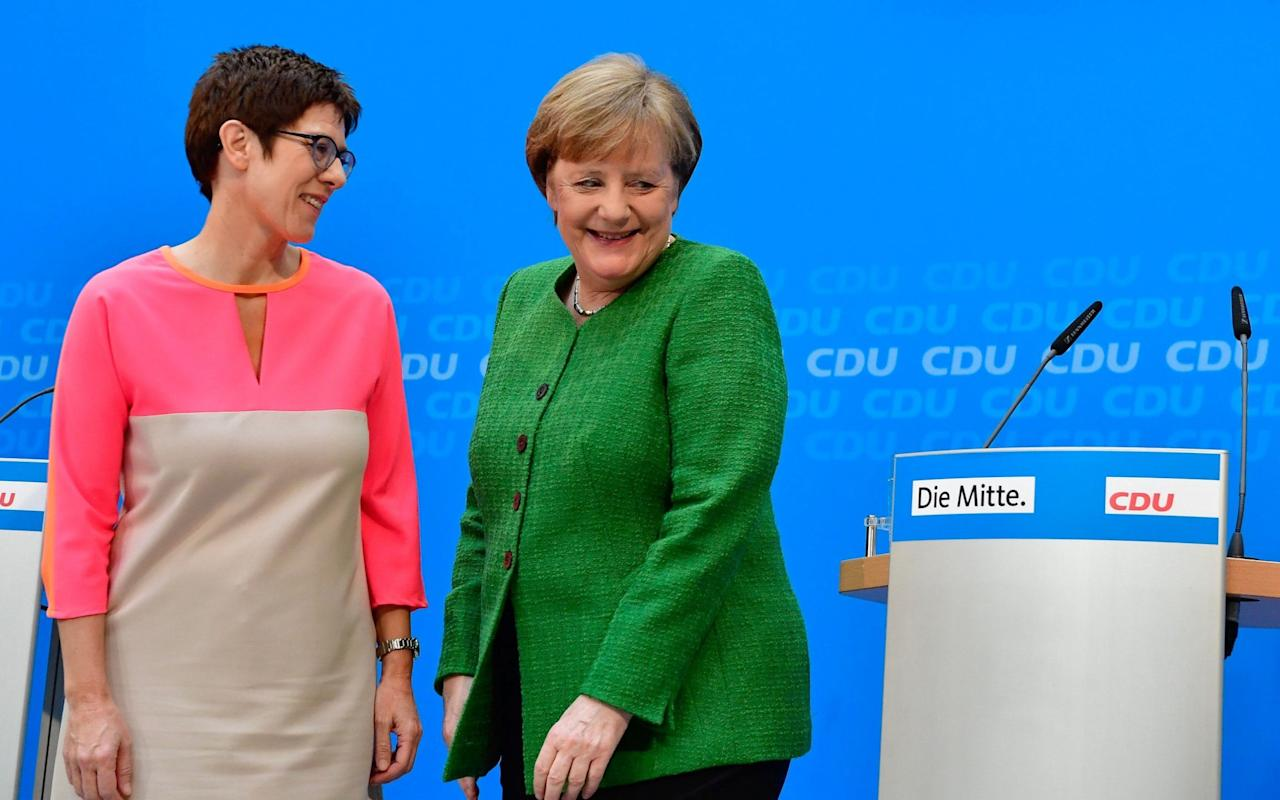 "In a move widely seen as anointing her chosen successor, Angela Merkel on Monday promoted one of her key lieutenants to a pivotal role as chairman of her Christian Democrat party (CDU). The appointment puts Annegret Kramp-Karrenbauer in pole position to take control of the party when Mrs Merkel eventually steps down or is forced from office.  Popularly known as ""mini-Merkel"", Ms Kramp-Karrenbauer has long been seen as the chancellor's preferred successor.  But Monday's move is the first sign that Mrs Merkel is now actively planning for the succession even as rival candidates begin to circle. The appointment of the loyalist Ms Kramp-Karrenbauer was also a signal that Mrs Merkel does not intend to give any ground to her critics within the party amid rumblings of discontent over the concessions she made to secure a new coalition deal. ""We can rely on each other, even if we each have our own opinions,"" Mrs Merkel said as she announced Ms Kramp-Karrenbauer's appointment.  The governor of German Saarland state and designated CDU Secretary General, Annegret Kramp-Karrenbauer, addresses a news conference after a party's leaders meeting in Berlin, Germany, Monday, Feb. 19, 2018 Credit:  AP The decision to make her party chairman has particular resonance because it was from the same office that Mrs Merkel launched her own successful bid to become CDU leader 18 years ago. Mrs Merkel had to fill the position after the current party chairman, Peter Tauber, announced he was stepping down because of ill health. But she said it was Ms Kramp-Karrenbauer who came to her and suggested the move. ""I was impressed by the idea,"" Mrs Merkel added. Although Ms Kramp-Karrenbauer has a formidable record as an election campaigner, all her experience so far has been in regional politics in her home state of Saarland, where she is currently prime minister. Mrs Merkel has been thought to want to give her protege a national role for some time in order to increase her profile. But with the CDU reduced to just six ministries in the new coalition deal, her options to bring Ms Kramp-Karrenbauer into the cabinet were limited.  Known as ""secretary-general"" in the German system, the role of party chairman is more powerful and independent than in UK politics, but does not come with a cabinet seat. Technically the appointment still has to be confirmed in a vote next week, but for the party to defy Mrs Merkel over the chairmanship would be unheard of. Accepting the nomination, Ms Kramp-Karrenbauer promised an overhaul of the party's policies. ""The discussion of the programme is open to everyone in the party, from the grassroots to the top,"" she said. Like her mentor, Ms Kramp-Karrenbauer has a reputation as a pragmatist not wedded to any particular ideology, though she has taken a stance against gay marriage. She has distanced herself from Mrs Merkel's controverisal refugee policy, but not as stridently as some her rivals — a shrewd move that may have contributed to Monday's appointment. Ms Kramp-Karrenbauer said she had not taken the decision to accept the role of party chairman easily. It is not without risks for her: it will cut her off from her power base in Saarland and will not give her the ministerial experience running a department would have."
