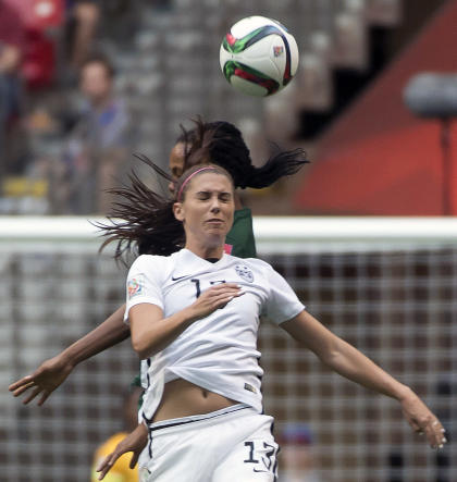 Basketball in the future of Alex Morgan? (Jonathan Hayward/The Canadian Press via AP)