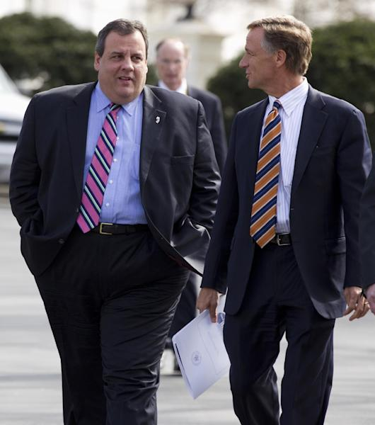 FILE - In this Feb. 27, 2012 file photo New Jersey Gov. Chris Christie, left, talks with Tennessee Gov. Bill Haslam, as they and other members of the National Governors Association members leave the White House in Washington after meeting with President Barack Obama and Vice President Joe Biden. A funny thing is happening between President Barack Obama and many Republican governors when it comes to improving America's schools: They are mostly getting along. (AP Photo/Carolyn Kaster)