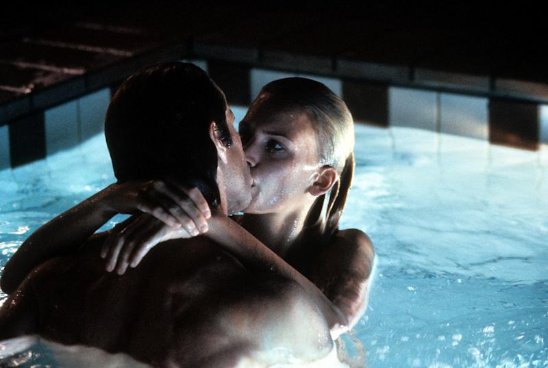 Natasha Henstridge in a swimming pool engaged in a kiss in a scene from the film 'Species', 1995. (Photo by Metro-Goldwyn-Mayer/Getty Images)