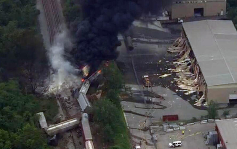 This image provided by WBAL-TV, shows a train derailment outside Baltimore on Tuesday, May, 28, 2013. A fire spokeswoman says the train derailed about 2 p.m. Tuesday in White Marsh, Md. (AP Photo/WBAL-TV)  MANDATORY CREDIT