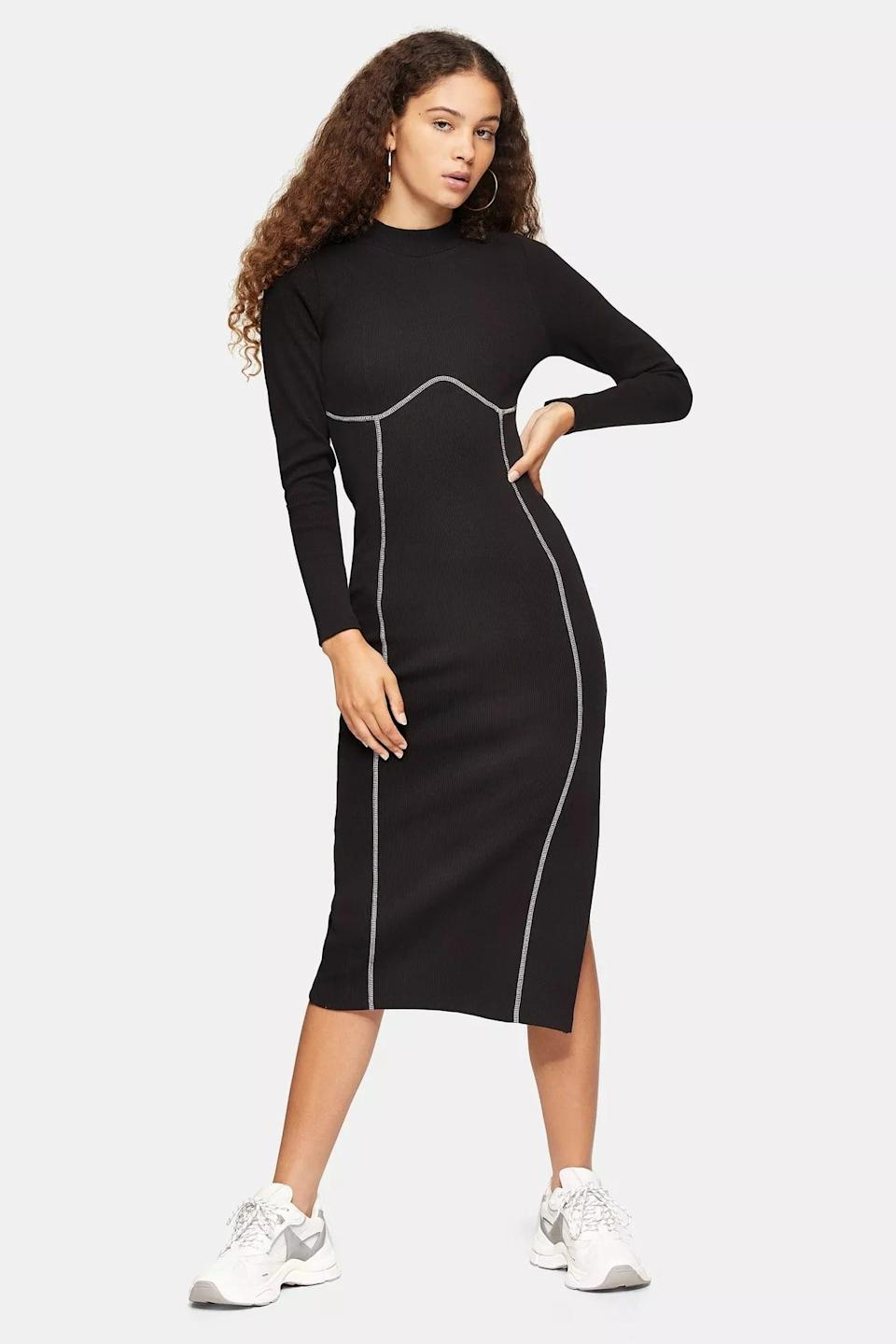 <p>This <span>Black Ribbed Long Sleeve Flatlock Midi Dress</span> ($58) will fashionably take you from day to night.</p>