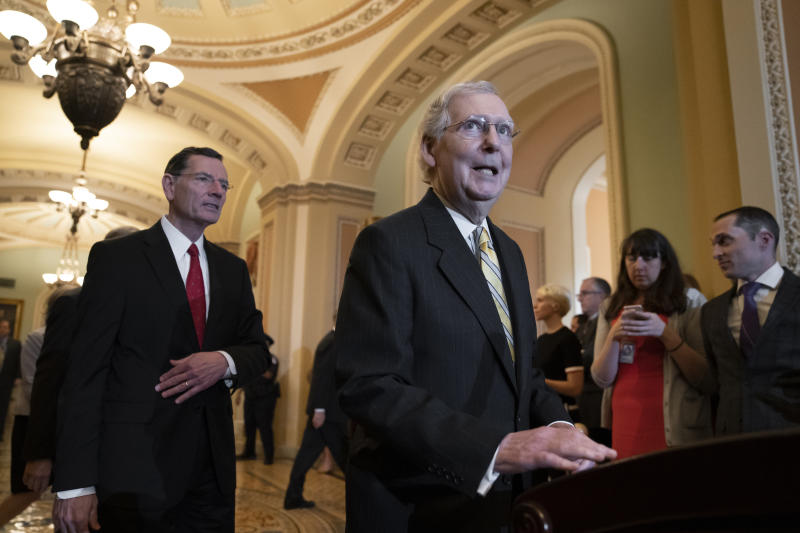 Senate Majority Leader Mitch McConnell, R-Ky., joined at left by Sen. John Barrasso, R-Wyo., answers questions about Senate Intelligence Committee Chairman Richard Burr, R-N.C., and his decision to subpoena Donald Trump Jr. who had backed out of two scheduled interviews as part of the panel's Russia investigation, during a news conference at the Capitol in Washington, Tuesday, May 14, 2019. (AP Photo/J. Scott Applewhite)