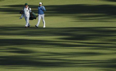 Apr 5, 2016; Augusta, GA, USA; Rory McIlroy and caddie Jean-Paul Fitzgerald walk down the 2nd fairway during a practice round for the 2016 Masters at Augusta National GC. Mandatory Credit: Rob Schumacher-USA TODAY Sports