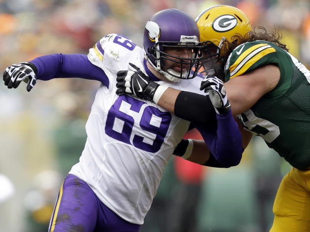 FILE - In this Nov. 24, 2013, file photo, Minnesota Vikings Jared Allen rushes during an NFL football during the game against the Green Bay Packers at the Lambeau Field in Green Bay Wis. The Chicago Bears replaced one accomplished veteran pass rusher with another Wednesday, March 26, 2014, when they agreed to terms with Allen on a four-year contract. A person with knowledge of the agreement told The Associated Press that Allen will get $15.5 million guaranteed on a deal that could be worth as much as $32 million. The person requested anonymity because the terms have not been announced. (AP Photo/Mike McGinnis, File)
