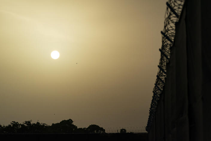 FILE - In this Aug. 29, 2021, file photo reviewed by U.S. military officials, the sun sets as seen from Camp Justice in Guantanamo Bay Naval Base, Cuba. Camp Justice is where the military commission proceedings are held for detainees charged with war crimes. The White House says it intends to shutter the prison on the U.S. base in Cuba, which opened in January 2002 and where most of the 39 men still held have never been charged with a crime. (AP Photo/Alex Brandon, File)