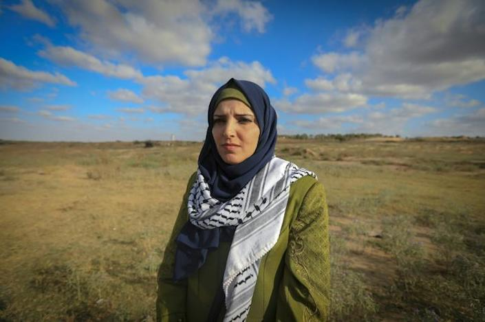 Jacqueline Shahada stands in the place where she was shot. 'I wish I had been killed, it would have been easier,' she told AFP (AFP Photo/Mahmud Hams)