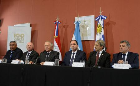 Fernando Marin (3rd L), coordinator of the bid to host the 2030 World Cup, speaks alongside Claudio Tapia (L), president of the Argentine Football Association (AFA), Argentina's Secretary of Sport Carlos Mac Allister (2nd L), Eduardo Abulafia (3rd R), head of Uruguay's delegation for the 2030 World Cup bid, Fernando Caceres, Uruguay's Secretary of Sport, and Wilmar Valdez, president of Uruguayan Football Association (AUF), during a news conference at the Casa Rosada Presidential Palace in Buenos Aires, Argentina April 9, 2018. Argentine Presidency/Handout via REUTERS ATTENTION EDITORS - THIS IMAGE WAS PROVIDED BY A THIRD PARTY.